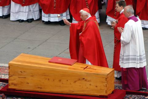 08 Apr 2005, Vatican City, Rome, Italy --- German Cardinal Joseph Ratzinger blesses the coffin of Pope John Paul II during his funeral in Saint Peter's Square. The Pope died at the age of 84. --- Image by © Kay Nietfeld/dpa/Corbis